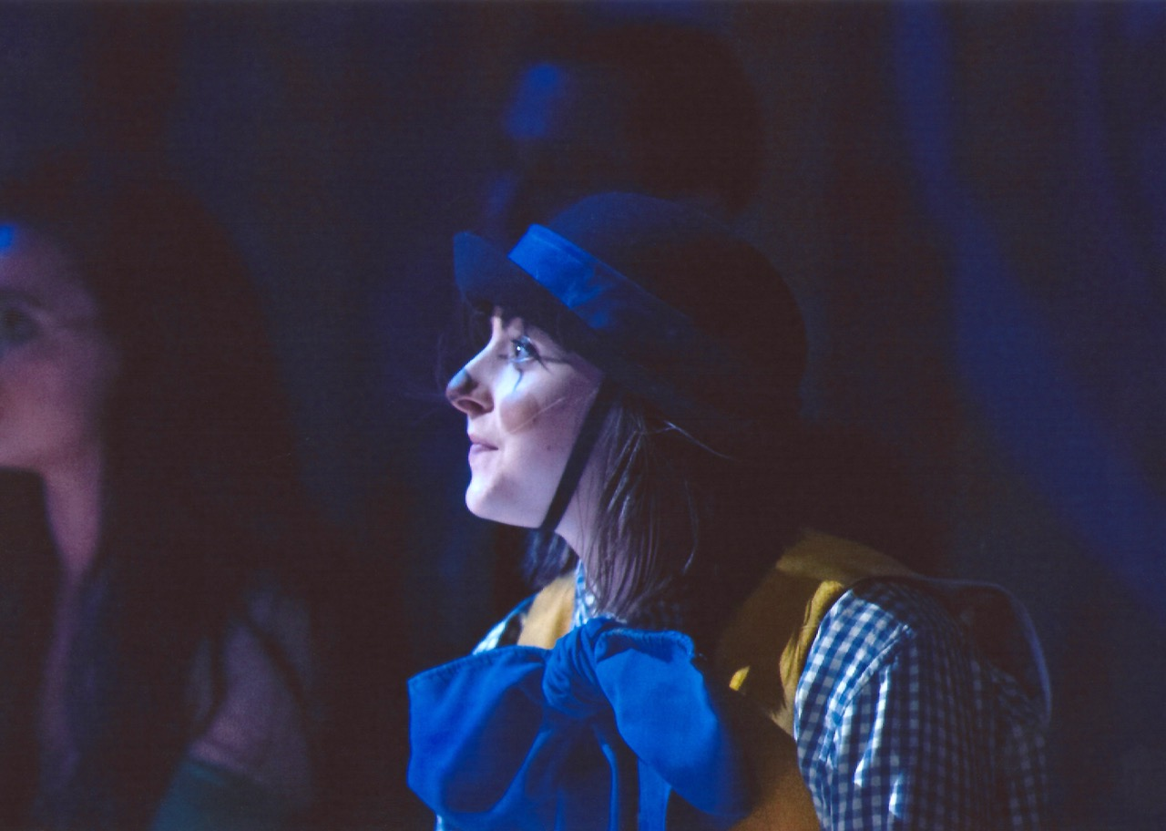 Dancer Megan Walters dressed as a clown with a bowler hat